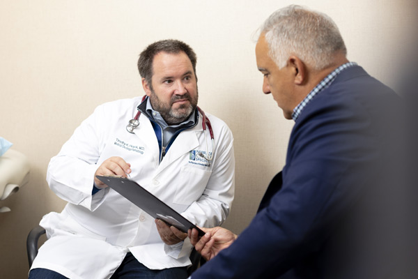 dr timothy huyck, medical oncologist, meeting with patient